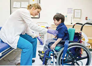 miracle-kid-sebastion-with-physical-therapist-ucsf-benioff-childrens-hospital