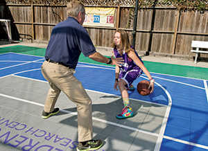 Sydney-on-court-with-bruce-ucsf-benioff-childrens-hospital-oakland