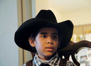 Isaac-with-cowboy-hat-in-chair-ucsf-benioff-childrens-hospital-oakland