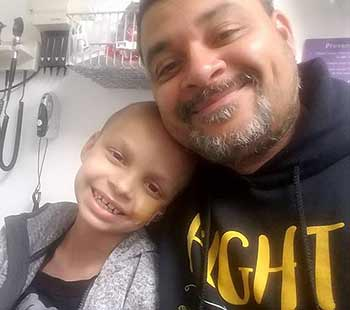 Childhood cancer patient devin and dad